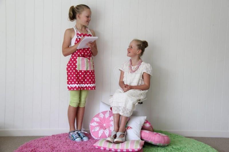 Bella & Ash posing on pink rug