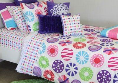Lou Lou quilt cover & sheeting, apple green rug & cushions; snow flake, velvet trim & purple rosette