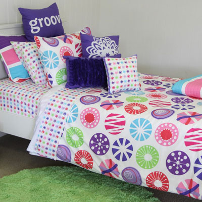 Lou Lou quilt cover & sheeting, apple green rug & cushions; snow flake, velvet trim & purple rosette