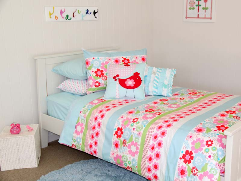 Charlotte quilt cover, doona with bell blue sheeting, red ribin cushions & sea blue rug