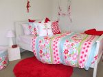 Charlotte quilt cover with regal red rug, red floral spiral and ballerina cushions