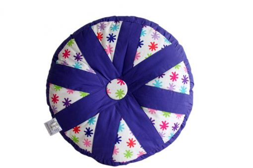 Purple and white Lou Lou Patchwork Cushion with red, blue, pink and green stars