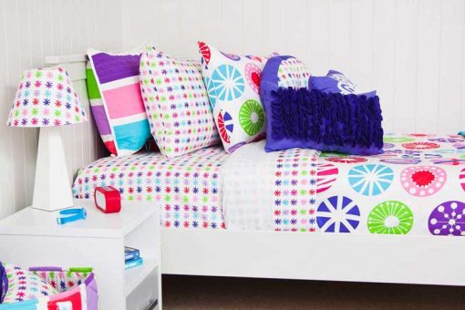 Multicoloured quilt cover with Purple Rosette cushion & Star lampshade