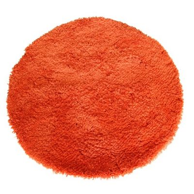 Orange circular shagpile rug
