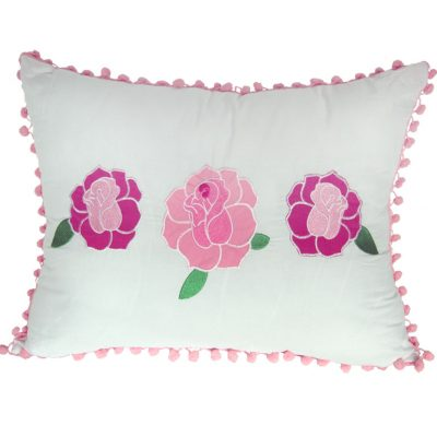 White cushions with embroidered pink roses & pink pompom edging