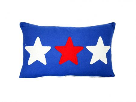 Mid blue cushion with red and white fabric stars