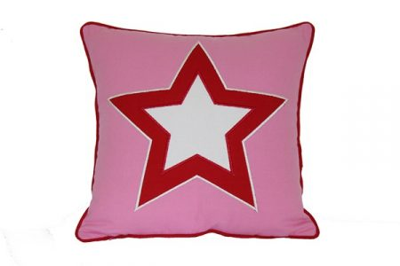 Pink square cushion with red & white star and red trim
