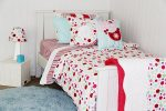Lucy candy coloured spot quilt cover with Sea Blue shagpile rug