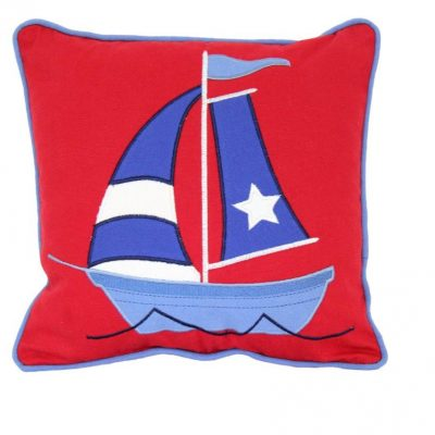 Red cushion with appliqued yacht