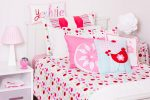 Lucy candy coloured spot quilt cover with Red Robin cushion