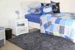 Tom quilt cover, Cobalt Blue sheeting, Rugby Ball cushions & Gunpowder Grey shagpile rug