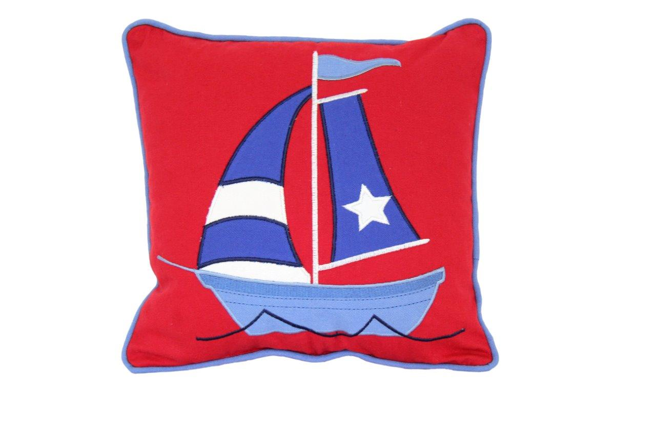 Red cushion with appliqued blue yacht