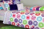 Lou Lou quilt cover, apple green rug & cushions; snow flake, velvet trim & purple rosette