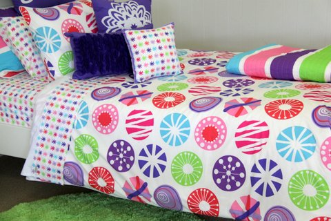 Lou Lou quilt cover, apple green rug & cushions; snow flake, velvet trim & purple rosette