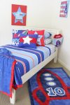 Nautical quilt cover and sheeting, blue with red trim throw and Rocket shortpile rug