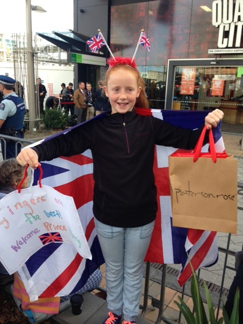 Millie with her banner & Patersonrose gift ready to greet Prince Harry