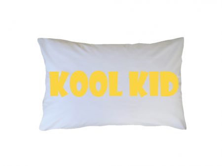 Crisp white cotton pillowcase with yellow Kool Kid wording
