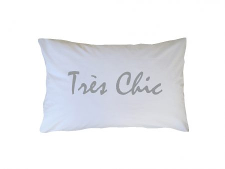 Crisp white cotton pillowcase with silver Tres Chic wording