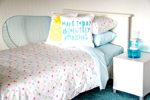 Ashely pastel spotted quilt cover, doona with pastel blue sheeting, make today aqua cushion and yellow pineapple cushion